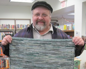 Jerry holding rug he made from jeans
