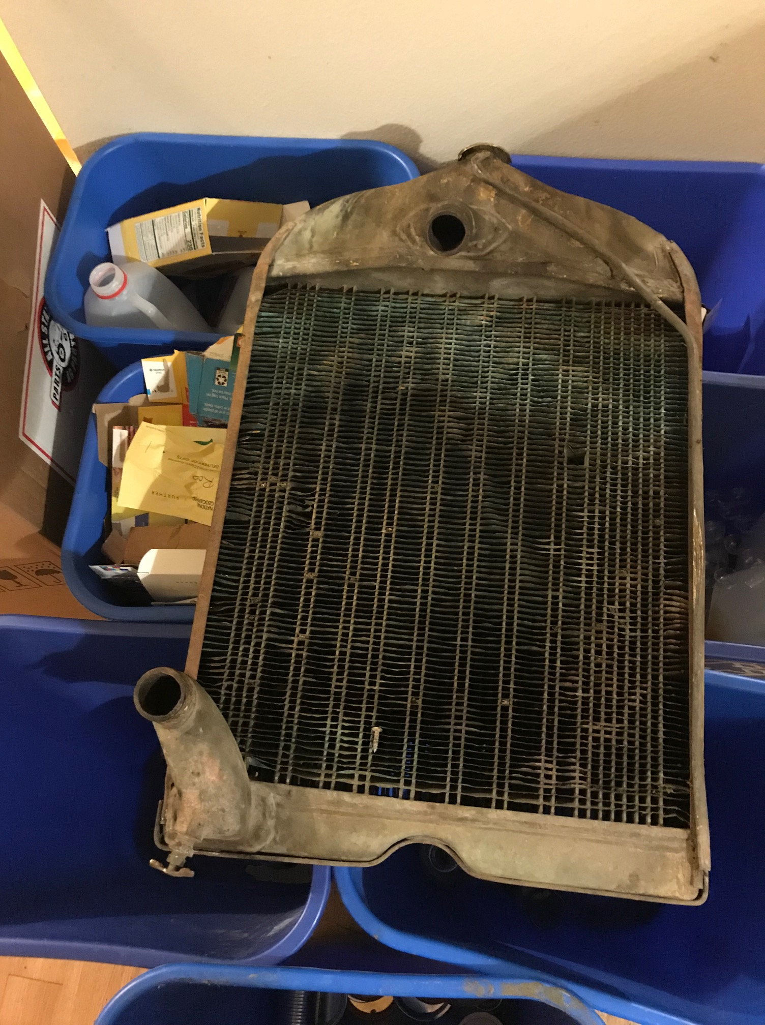 Photograph of tractor radiator sitting on the recycling bins